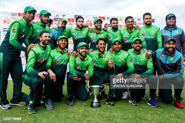 Pakistan's pose with the trophy during the price ceremony after winning the fifth OneDay International series final cricket match against Zimbabwe at...