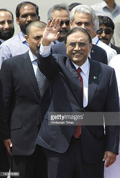 Pakistan's President Asif Ali Zardari accompanied by his son and Pakistan People's Party Chief Bilawal Bhutto Zardari arrives at Palam Technical...