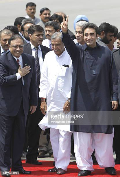 Pakistan's President Asif Ali Zardari accompanied by his son and Pakistan People's Party Chief Bilawal Bhutto Zardari are received by India's...