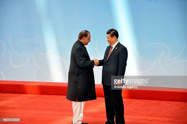 Pakistan's President Mamnoon Hussain is greeted by Chinese President Xi Jinping before the opening ceremony at the fourth Conference on Interaction...
