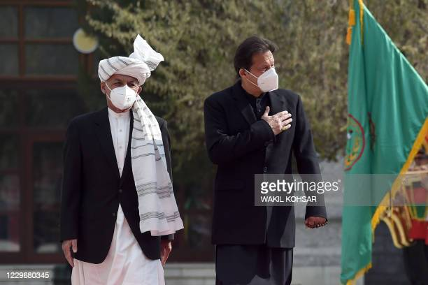 Pakistan's Prime Minister Imran Khan and Afghan President Ashraf Ghani inspect a guard of honour ahead of their joint press conference at the...