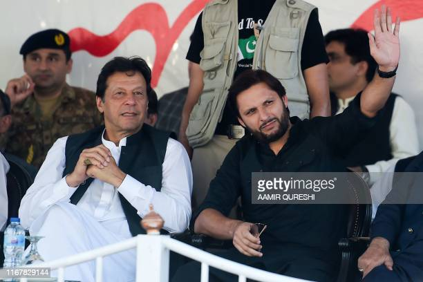Pakistan's Prime Minister Imran Khan and former cricketer Shahid Afridi attend a rally in Muzaffarabad on September 13, 2019. - Pakistani prime...