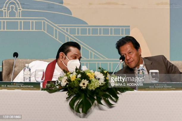 Pakistan's Prime Minister Imran Khan and his Sri Lankan counterpart Mahinda Rajapakse talk during a Trade and Investments conference in Colombo on...