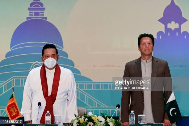 Pakistan's Prime Minister Imran Khan and his Sri Lankan counterpart Mahinda Rajapakse stand for the national anthems during a Trade and Investments...