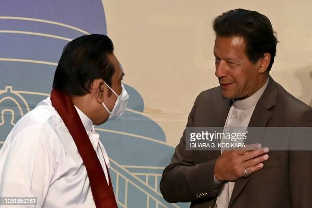 Pakistan's Prime Minister Imran Khan and his Sri Lankan counterpart Mahinda Rajapaksa talk at the end of the Trade and Investments conference in...