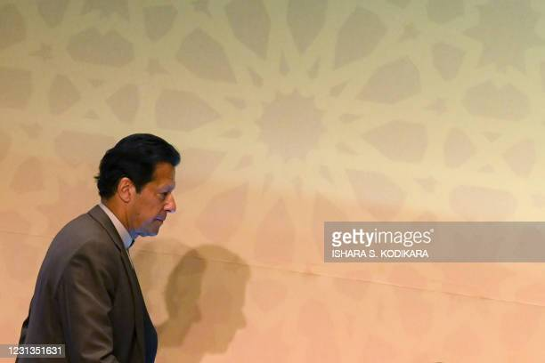 Pakistan's Prime Minister Imran Khan arrives at a Trade and Investments conference in Colombo on February 24, 2021 on the second day of Khan's...