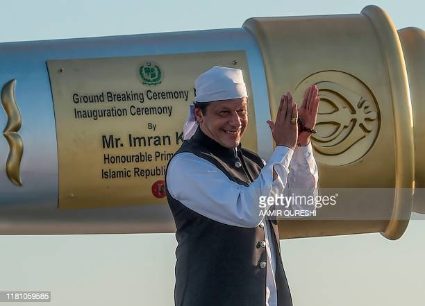Pakistan's Prime Minister Imran Khan claps after inaugurating the ceremony at the Shrine of Baba Guru Nanak Dev at Gurdwara Darbar Sahib in Kartarpur...