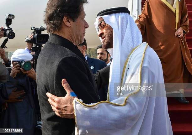 Pakistan's Prime Minister Imran Khan greets Abu Dhabi's Crown Prince Sheikh Mohamed bin Zayed AlNahyan upon his arrival at the military Nur Khan Air...