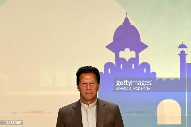 Pakistan's Prime Minister Imran Khan looks on during a Trade and Investments conference in Colombo on February 24, 2021 on the second day of Khan's...