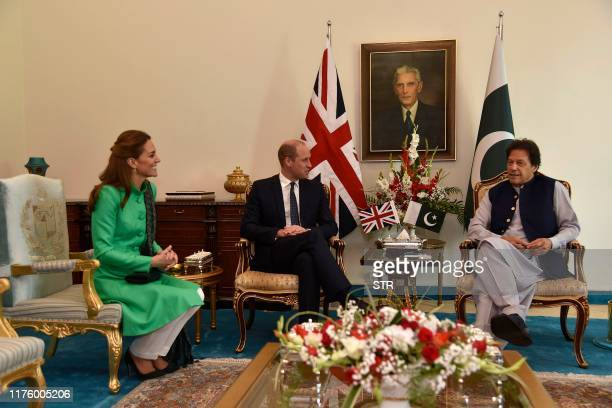 Pakistan's Prime Minister Imran Khan meets with Britain's Prince William Duke of Cambridge and his wife Catherine Duchess of Cambridge at the Prime...