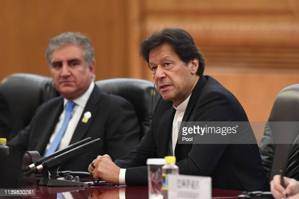 Pakistan's Prime Minister Imran Khan right speaks during a meeting with China's President Xi Jinping at the Great Hall of the People on April 28 2019...
