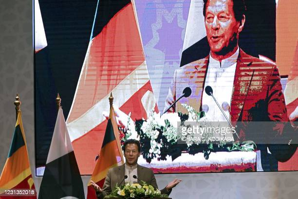 Pakistan's Prime Minister Imran Khan speaks at the Trade and Investments conference in Colombo on February 24, 2021 on the second day of Khan's...