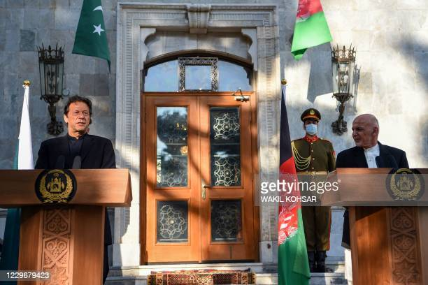 Pakistan's Prime Minister Imran Khan speaks during a joint press conference with Afghan President Ashraf Ghani at the Presidential Palace in Kabul on...