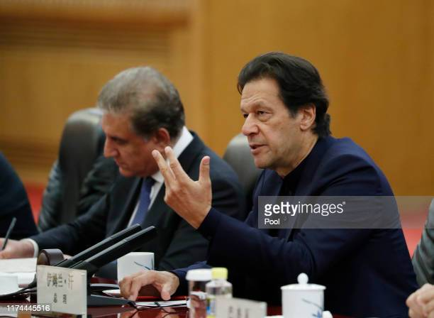 Pakistan's Prime Minister Imran Khan speaks during a meeting with Chinese Premier Li Keqiang at the Great Hall of the People in Beijing on October 8,...