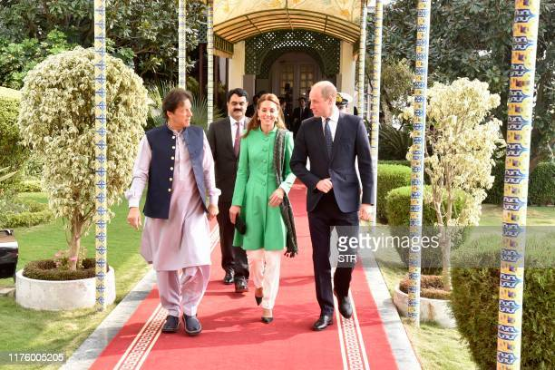 Pakistan's Prime Minister Imran Khan walks with Britain's Prince William Duke of Cambridge and his wife Catherine Duchess of Cambridge at the Prime...
