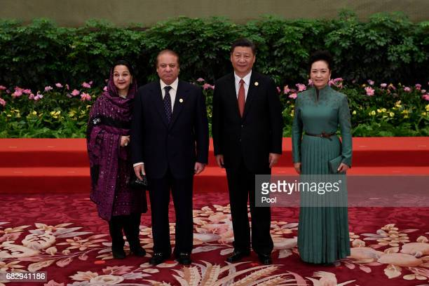 Pakistan's Prime Minister Nawaz Sharif and his wife Kalsoom Nawaz Sharif pose with Chinese President Xi Jinping and his wife Peng Liyuan during a...
