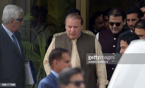 Pakistan's Prime Minister Nawaz Sharif leaves with his son Hussain Nawaz after appearing before an anticorruption commission at the Federal Judicial...