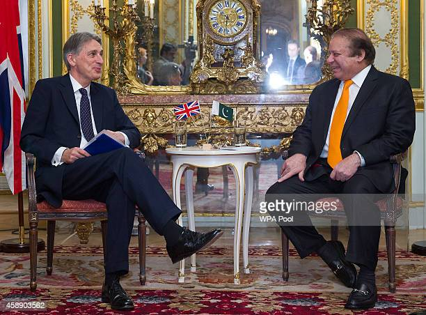 Pakistan's Prime Minister Nawaz Sharif meets with British Foreign Secretary Philip Hammond after the opening session of the UKPakistan Energy...