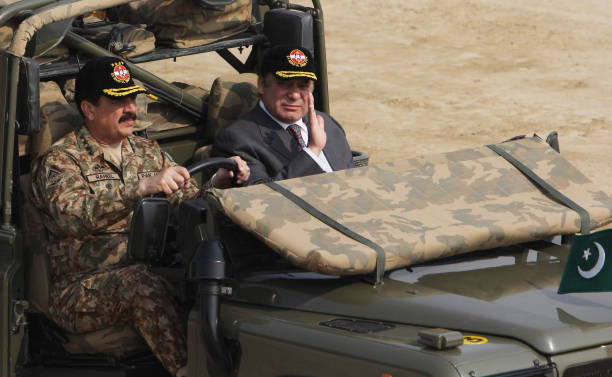Pakistan`s Prime Minister Nawaz Sharif sits next to Pakistani Army Chief General Raheel Sharif in an army vehicle to attend a military exercise at a..