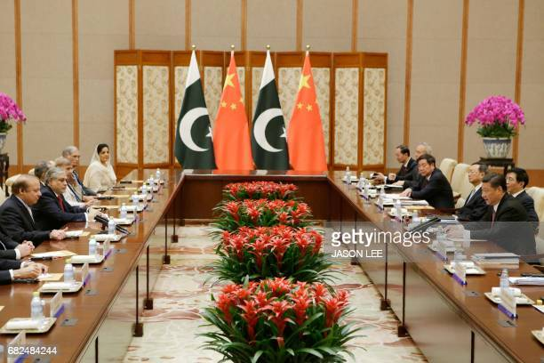 Pakistan's Prime Minister Nawaz Sharif talks with China's President Xi Jinping ahead of the Belt and Road Forum in Beijing on May 13 2017 / AFP PHOTO...