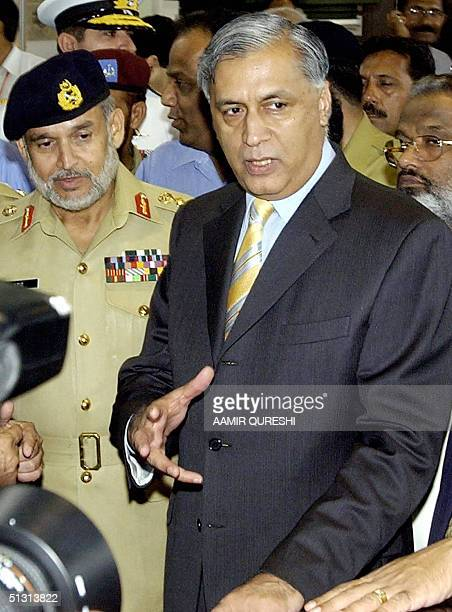 Pakistan's Prime Minister Shaukat Aziz speaks to media representatives as Pakistan's Chairman Joint Chief of Staff Committee General Abdul Aziz Khan...