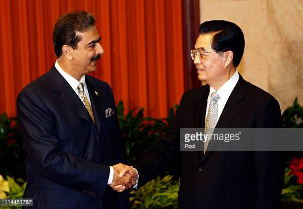 Pakistan's Prime Minister Yusuf Raza Gilani shakes hands with China's President Hu Jintao during a meeting at the Great Hall of the People on May 20,...