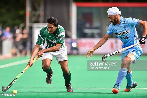 Pakistan's Rasool Shafqat vies with India's Gurmail Singh during the Group A field hockey match between Pakistan and India of the men's group stage...