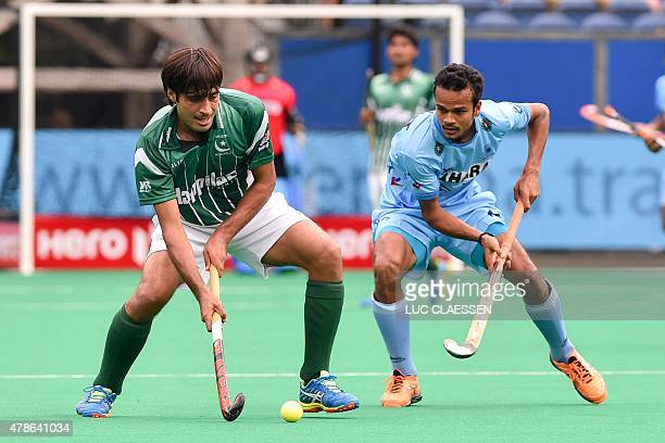 Pakistan's Rizwan Senior Muhammad controls the ball during the field hockey match between Pakistan and India in the men's Group A of the World League...