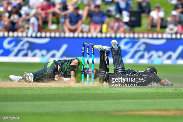 Pakistan's Rumman Raees attempts to run out New Zealand's Tom Latham during the 5th oneday international cricket match between New Zealand and...