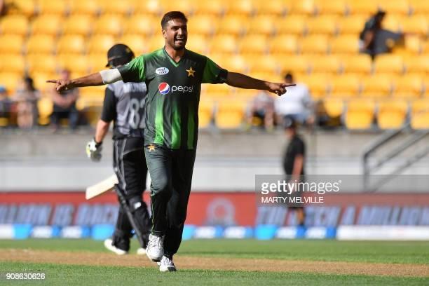 Pakistan's Rumman Raees celebrates bowling New Zealand's Glenn Phillips during the first Twenty20 international cricket match between New Zealand and...