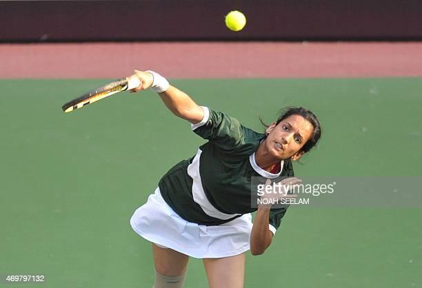 Pakistan's Sarah Mansoor serves to India's Prarthana G Thombare during the Fed Cup AsiaOceana Group II Tennis Championship at Fateh Maidan Tennis...