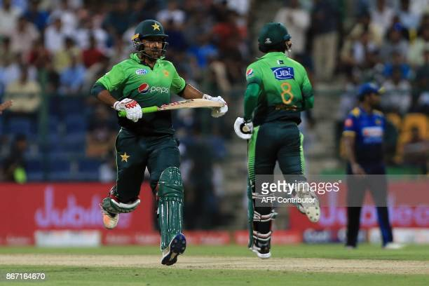 Pakistan's Sarfaraz Ahmed and Muhammad Hafessz run between the wicket during the second Twenty20 series cricket match Pakistan vs Sri Lanka on...
