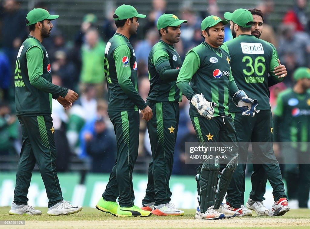 Pakistan's Sarfraz Ahmed (3R) celebrates with teammates at the end of second Twenty20 International cricket match between Scotland and Pakistan at the Grange Cricket Club in Edinburgh, Scotland, on June 13, 2018. - Pakistan won by 84 runs.
