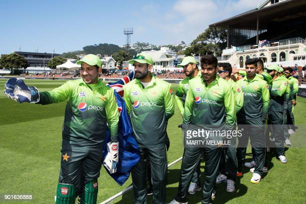 Pakistan's Sarfraz Ahmed leas the team onto the field for the national anthems during the first one day international cricket match between New...