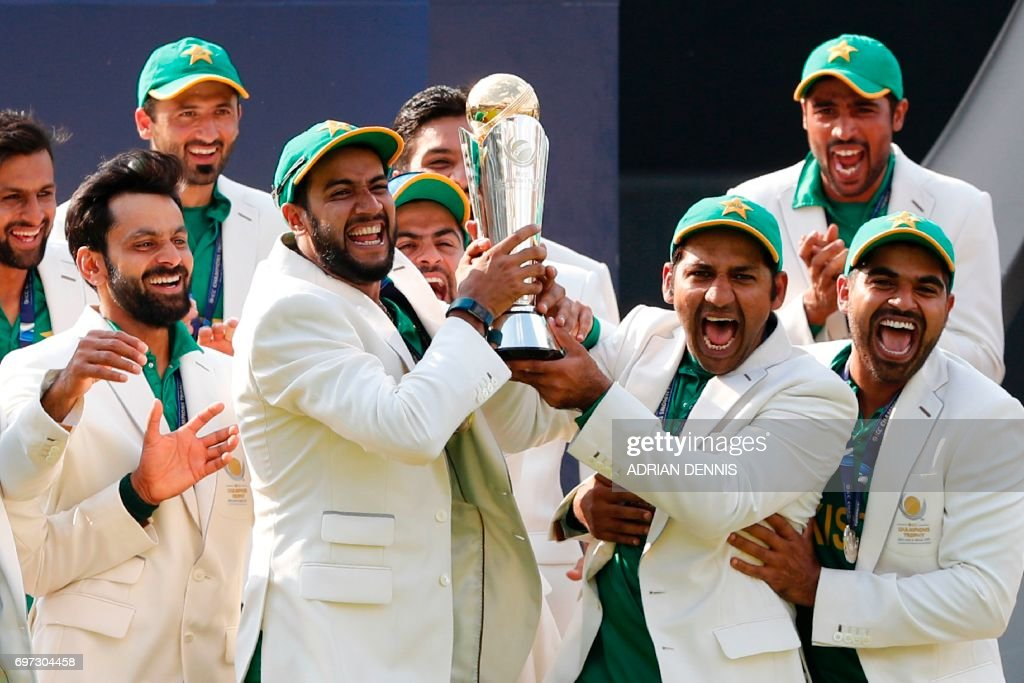 Pakistan's Sarfraz Ahmed (3R) lifts the trophy as Pakistan players celebrate their win at the presentation after the ICC Champions Trophy final cricket match between India and Pakistan at The Oval in London on June 18, 2017. Pakistan thrashed title-holders India by 180 runs to win the Champions Trophy final at The Oval on Sunday. PHOTO / Adrian DENNIS / RESTRICTED