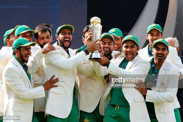 Pakistan's Sarfraz Ahmed lifts the trophy as Pakistan players celebrate their win at the presentation after the ICC Champions Trophy final cricket...