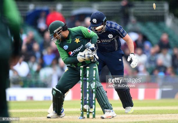 Pakistan's Sarfraz Ahmed takes with wicket of Scotland's Mark Watt during the second Twenty20 International cricket match between Scotland and...