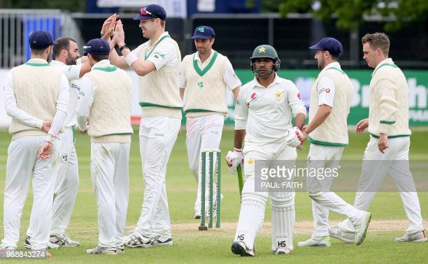 Pakistan's Sarfraz Ahmed walks back to the pavilion after losing his wicket for 20 runs on the final day of Ireland's inaugural test match against...