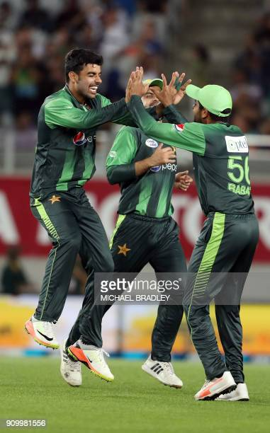 Pakistan's Shadab Khan and Babar Azam celebrate the wicket of New Zealand's Martin Guptill during the second Twenty20 international cricket match...