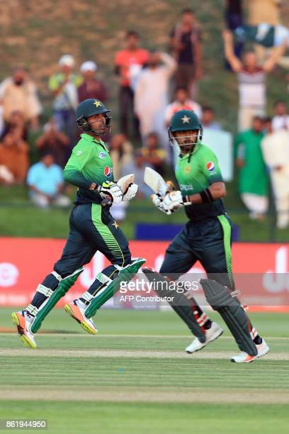 Pakistan's Shadab Khan and Babar Azam run between the wicket during the second one day international cricket match between Sri Lanka and Pakistan at...