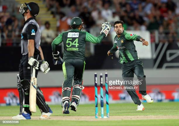 Pakistan's Shadab Khan and Sarfraz Ahmed celebrate the wicket of Colin de Grandhomme during the second Twenty20 international cricket match between...
