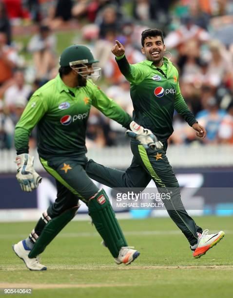 Pakistan's Shadab Khan and Sarfraz Ahmed celebrates the wicket of New Zealand's Tom Latham during the fourth oneday international cricket match...