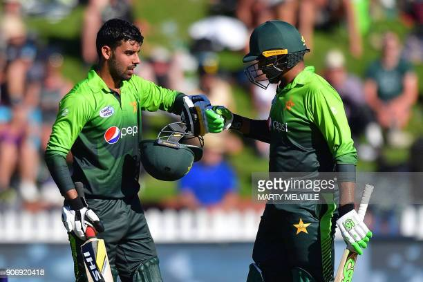 Pakistan's Shadab Khan celebrates 50 runs with by teammate Haris Sohail during the 5th oneday international cricket match between New Zealand and...