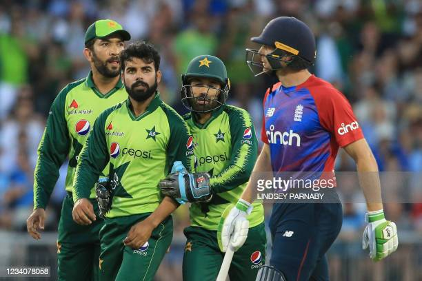 Pakistan's Shadab Khan celebrates taking the wicket of England's Jos Buttler for 21 during the third T20 international cricket match between England...