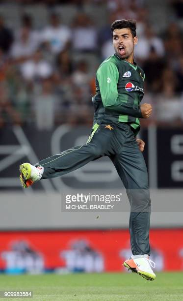 Pakistan's Shadab Khan celebrates the wicket of Colin de Grandhomme during the second Twenty20 international cricket match between New Zealand and...