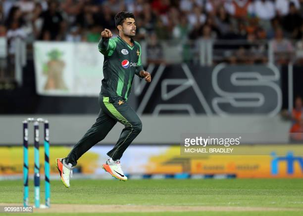 Pakistan's Shadab Khan celebrates the wicket of New Zealand's Martin Guptill during the second Twenty20 international cricket match between New...