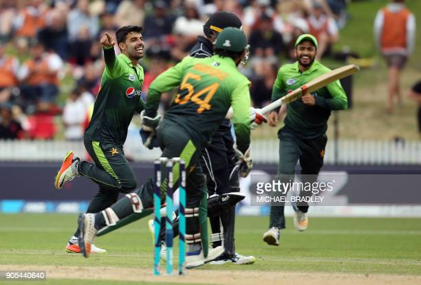 Pakistan's Shadab Khan celebrates the wicket of New Zealand's Tom Latham during the fourth oneday international cricket match between New Zealand and...