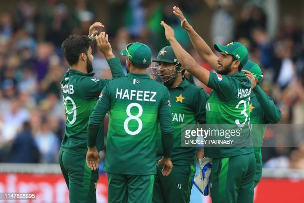 Pakistan's Shadab Khan celebrates with teammates after taking the wicket of England's Joe Root for 107 during the 2019 Cricket World Cup group stage...