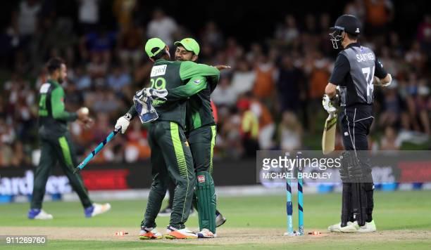 Pakistan's Shadab Khan hugs Sarfraz Ahmed as they celebrate winning the third Twenty20 international cricket match between New Zealand and Pakistan...