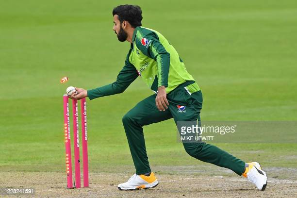 Pakistan's Shadab Khan runs out England's Dawid Malan during the international Twenty20 cricket match between England and Pakistan at Old Trafford...